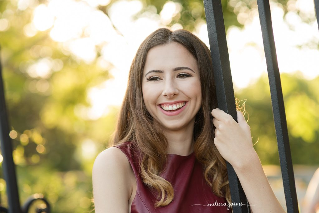 senior girl from shadyside pa stands against an iron gate for senior portrait session in Pittsburgh PA